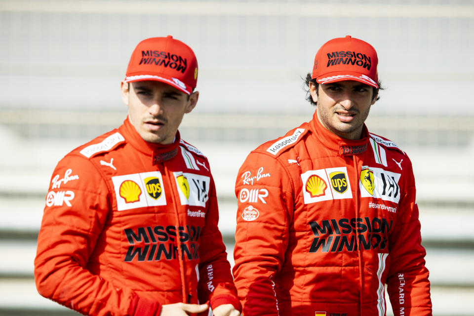 BAHRAIN, BAHRAIN - MARCH 12: Carlos Sainz of Spain and Ferrari and Charles Leclerc of Monaco and Ferrari look on from the grid during Day One of F1 Testing at Bahrain International Circuit on March 12, 2021 in Bahrain, Bahrain. (Photo by Mark Thompson/Getty Images)