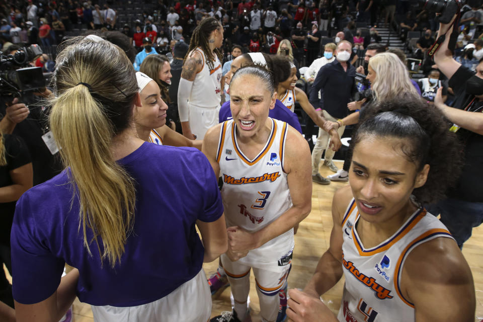 Phoenix Mercury guard Diana Taurasi (3) celebrates with teammates after the Mercury defeated the Las Vegas Aces 87-84 in Game 5 of a WNBA basketball playoff series Friday, Oct. 8, 2021, in Las Vegas. (AP Photo/Chase Stevens)