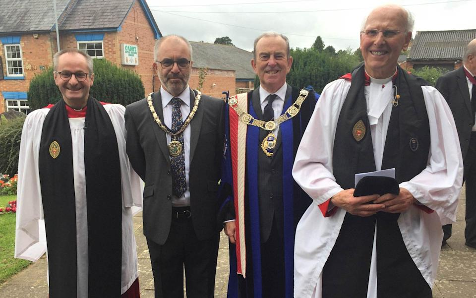 The Very Revd Derek Hole, far right, and the Venerable Tim Stratford, Archdeacon of Leicester, far left, with local dignitaries after the Framework Knitters' annual service at St Peter's Church, Oadby - Peter White