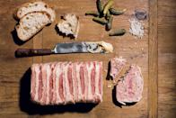 """Mix ground bacon with ground fresh pork, Cognac, cream, and spices, then layer with ham and drape with bacon for this old school-style appetizer. Don't forget the <a href=""""https://www.epicurious.com/expert-advice/cornichons-are-the-best-not-very-fancy-fancy-snack-article?mbid=synd_yahoo_rss"""" rel=""""nofollow noopener"""" target=""""_blank"""" data-ylk=""""slk:cornichons"""" class=""""link rapid-noclick-resp"""">cornichons</a>! <a href=""""https://www.epicurious.com/recipes/food/views/country-pate-em-pate-de-campagne-em-350966?mbid=synd_yahoo_rss"""" rel=""""nofollow noopener"""" target=""""_blank"""" data-ylk=""""slk:See recipe."""" class=""""link rapid-noclick-resp"""">See recipe.</a>"""
