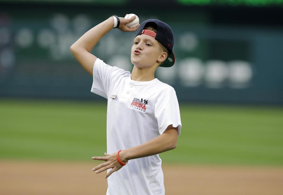 Chris Garcia throws out the ceremonial first pitch before a baseball game between the Washington Nationals and the Atlanta Braves at Nationals Park Tuesday, Aug. 6, 2013, in Washington. (AP Photo/Alex Brandon)