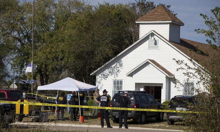 <p>Law enforcement officials investigate a mass shooting at the First Baptist Church in Sutherland Springs, Texas, Nov. 5, 2017. (Nick Wagner/American-Statesman via AP) </p>