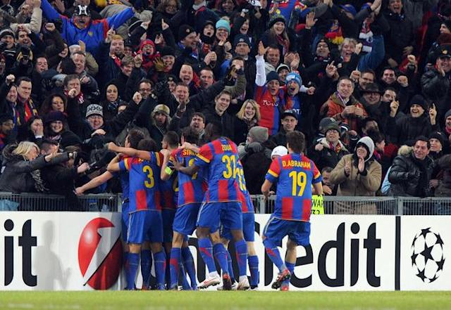 Several Basel players celebrate after the first goal for their team during the UEFA Champions League round of sixteen first leg match between Bayern Munich and FC Basel in the St. Jakob stadium in Basel, Switzerland, on February 22, 2012. Basel won the match 1-0. (Photo by Christof Stache/AFP/Getty Images)