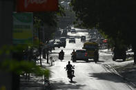 People drive on a main road in Port-au-Prince, Haiti, Saturday, July 10, 2021, three days after President Jovenel Moise was assassinated in his home. (AP Photo / Matias Delacroix)