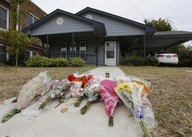 FILE - In this Monday, Oct. 14, 2019 photo, flowers lie on the sidewalk in front of the house in Fort Worth, Texas, where a white Fort Worth police officer Aaron Dean shot and killed Atatiana Jefferson, a black woman, through a back window of her home. Dean resigned before he could be compelled to undergo questioning. After a police officer fatally shoots someone, it can take days or even weeks before the public or his supervisors hear the officer's version of what happened. (AP Photo/David Kent, File)