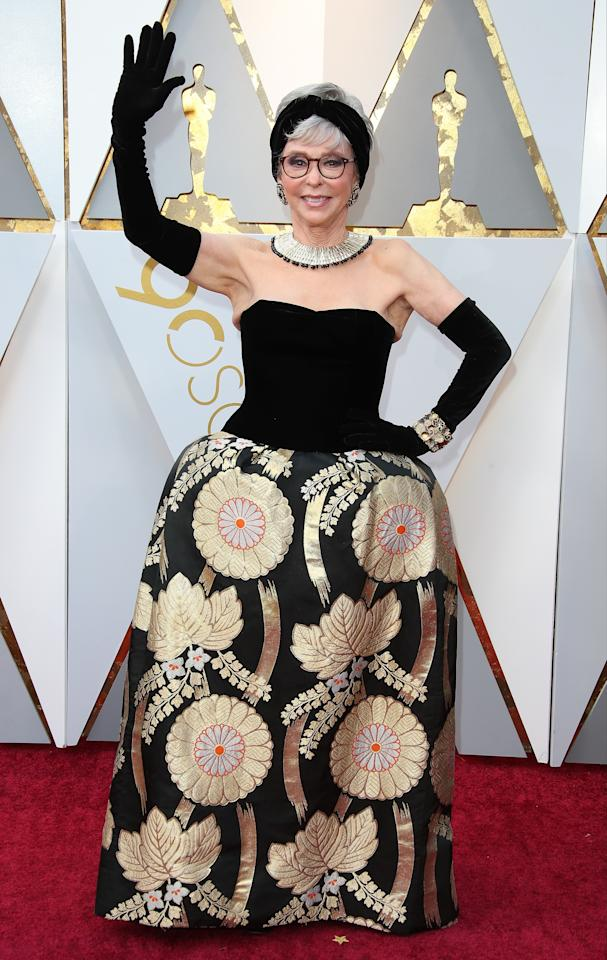 <p>Veteran actress Rita rewore the gown she originally donned for the Oscars in 1962 – and looked every bit as amazing (Getty Images) </p>