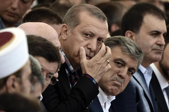 Turkish President Recep Tayyip Erdogan (C) and his predecessor Abdullah Gul (C-R) co-founded the ruling AKP party (AFP Photo/ARIS MESSINIS)