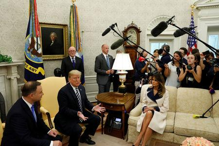 U.S. President Donald Trump speaks next to first lady Melania Trump during a meeting with Poland's President Andrzej Duda in the Oval Office of the White House in Washington U.S