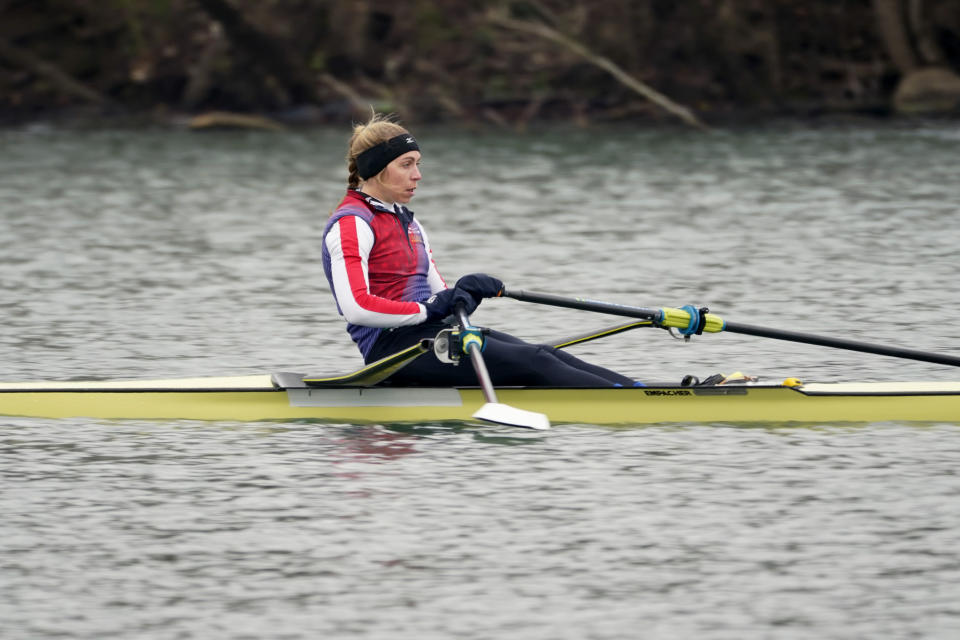Rower Gevvie Stone trains at Lady Bird Lake ahead of the upcoming U.S. Olympic rowing trials, Friday, Feb. 12, 2021, in Austin, Texas. Stone is getting closer to a hopeful return to the Olympics and eventually the medical career she has put on hold for nearly three years. The silver medalist at the 2016 Rio de Janeiro Olympics came out of retirement and postponed her medical career as an emergency physician for one last chance at a gold medal. (AP Photo/Eric Gay)