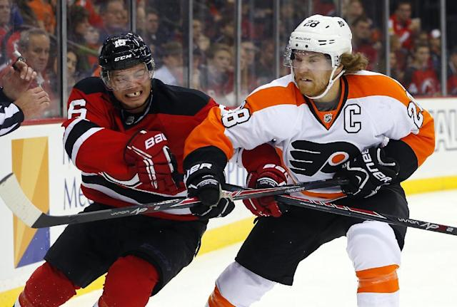 New Jersey Devils' Jacob Josefson, left, of Sweden, battles Philadelphia Flyers' Claude Giroux during the second period of an NHL hockey game in Newark, N.J., Saturday, Nov. 2, 2013. (AP Photo/Rich Schultz)
