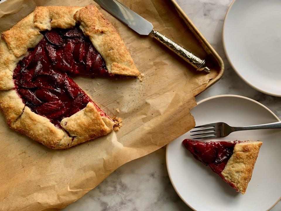 """<p><strong>Recipe: </strong><a href=""""https://www.southernliving.com/recipes/plum-galette"""" rel=""""nofollow noopener"""" target=""""_blank"""" data-ylk=""""slk:Honeyed Plum Galette"""" class=""""link rapid-noclick-resp""""><strong>Honeyed Plum Galette</strong></a></p> <p>A few impactful ingredients create quite the medley of flavor in our Honeyed Plum Galette. Cardamom, gingersnaps, and—of course—the most perfectly ripe plums you can get your hands on will steal the show.</p>"""