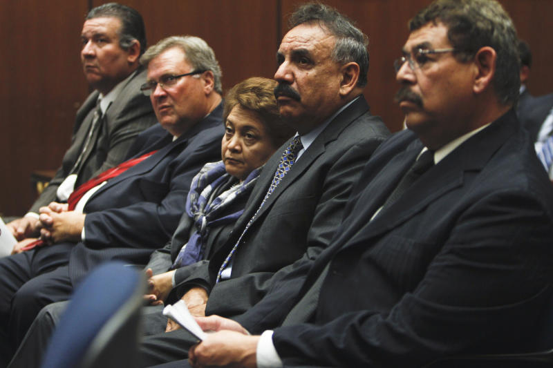 "From left, Luis Artiga, George Cole, Teresa Jacobo, Oscar Hernandez  and George Mirabal listen during a preliminary hearing on Monday, Feb.  7, 2011 in Los Angeles.  Eight current and former officials with the city of Bell, including the mayor, vice mayor and former city manager , are named in dozens of counts of misappropriation of public funds in a scandal that District Attorney Steve Cooley described as ""corruption on steroids"" on the day they were taken from their homes in handcuffs last September.  (AP Photo/Mark Boster, Pool)"