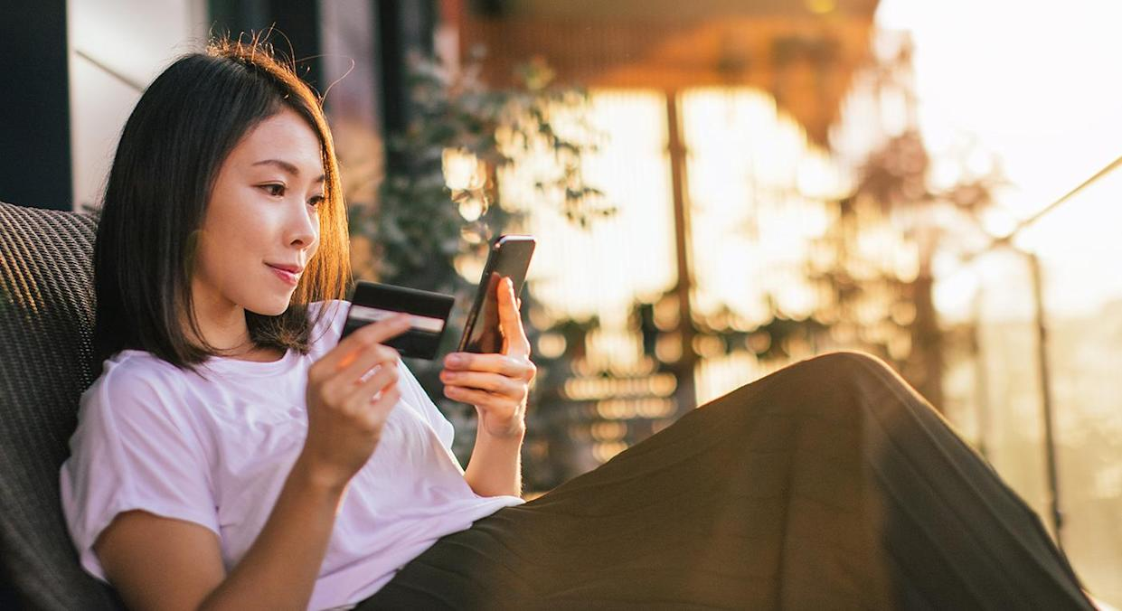 A shopping spree is a no-brainer, especially when a sale on designer buys is available.  (Getty Images)