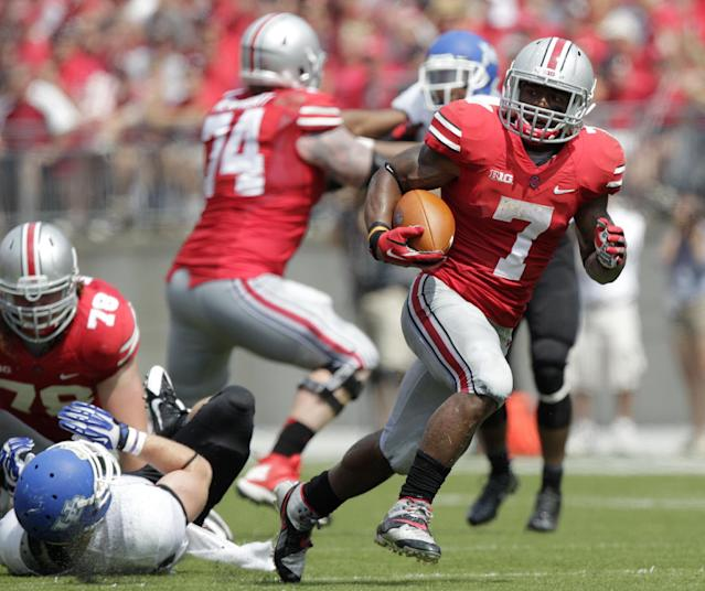 Ohio State running back Jordan Hall, right, crosses the line of scrimmage on his way to scoring a touchdown against Buffalo during the second quarter of an NCAA college football game Saturday, Aug. 31, 2013, in Columbus, Ohio. (AP Photo/Jay LaPrete)