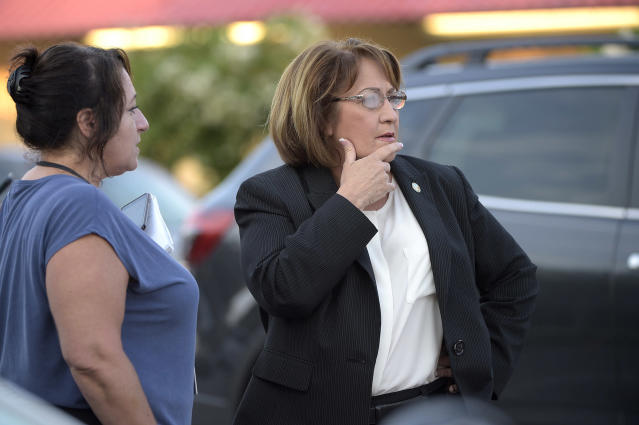 <p>Orange County Mayor Teresa Jacobs, right, is briefed after arriving to the scene of a fatal shooting at Pulse Orlando nightclub in Orlando, Fla., Sunday, June 12, 2016. (AP Photo/Phelan M. Ebenhack) </p>