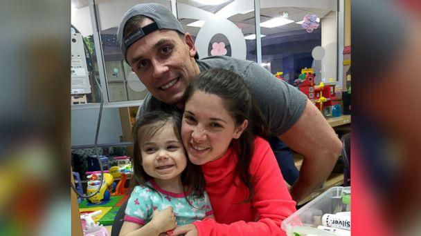 PHOTO: Shelby and Jonathan Skiles pose with their 2-year-old daughter Sophie who was diagnosed with T-cell lymphoma in May. (Shelby Skiles)