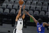 San Antonio Spurs forward Trey Lyles (41) shoots over New York Knicks guard Immanuel Quickley (5) during the first half of an NBA basketball game in San Antonio, Tuesday, March 2, 2021. (AP Photo/Eric Gay)