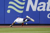 New York Mets center fielder Kevin Pillar (11) cannot catch an RBI-triple by Cincinnati Reds' Kyle Farmer, scoring Jesse Winker, during the sixth inning of a baseball game, Sunday, Aug. 1, 2021, in New York. (AP Photo/Corey Sipkin)