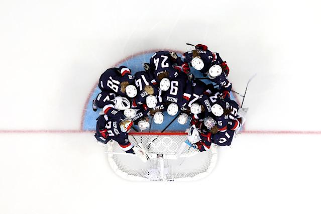 SOCHI, RUSSIA - FEBRUARY 17: The United States huddle around the net before the Women's Ice Hockey Playoffs Semifinal game against Sweden on day ten of the Sochi 2014 Winter Olympics at Shayba Arena on February 17, 2014 in Sochi, Russia. (Photo by Bruce Bennett/Getty Images)