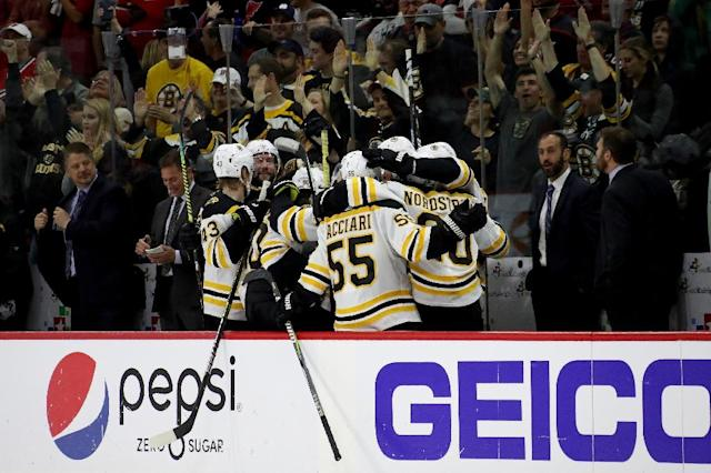 Boston Bruins players celebrate a goal en route to a series-clinching 4-0 win over the Carolina Hurricanes (AFP Photo/BRUCE BENNETT)