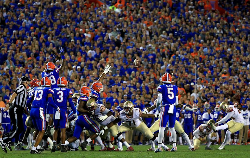 GAINESVILLE, FLORIDA - NOVEMBER 30: Ricky Aguayo #23 of the Florida State Seminoles kicks a field goal during a game against the Florida Gators at Ben Hill Griffin Stadium on November 30, 2019 in Gainesville, Florida. (Photo by Mike Ehrmann/Getty Images)