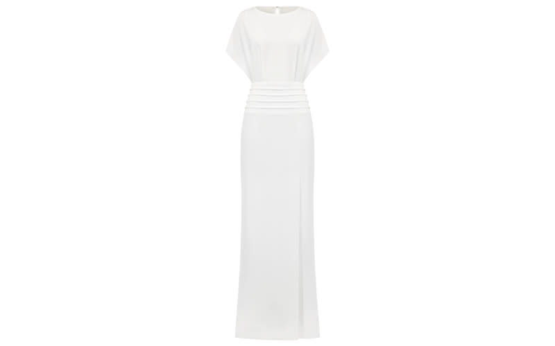 """<p>An evening gown that wouldn't look out of place at a black tie event, the 'Monterose' is sure to please the fuss-free bride-to-be. <a rel=""""nofollow noopener"""" href=""""https://www.outlinelondon.com/ivory-monterose-dress"""" target=""""_blank"""" data-ylk=""""slk:Shop now"""" class=""""link rapid-noclick-resp""""><em>Shop now</em></a>. </p>"""