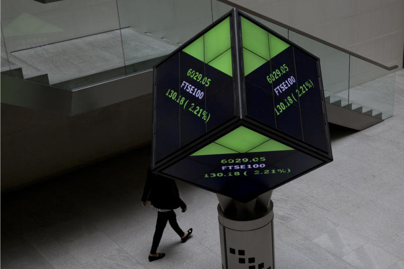 FTSE market information is displayed on a cube-shaped display inside the London Stock Exchange in the City of London, Tuesday, Aug. 25, 2015. Chinese stocks fell Tuesday for a fourth day, hitting an eight-month low amid signs Beijing was no longer buying shares to stem a price slide, and Japanese stocks also dropped. But other Asian and European markets bounced back from a day of heavy losses. (AP Photo/Matt Dunham)