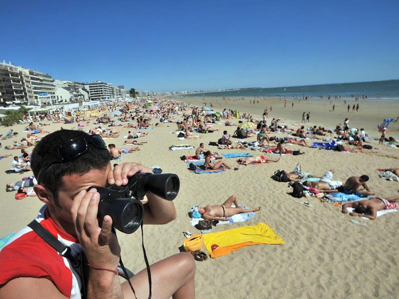 A lifeguard looks out over La Baule beach: RANK PERRY/AFP/Getty Images