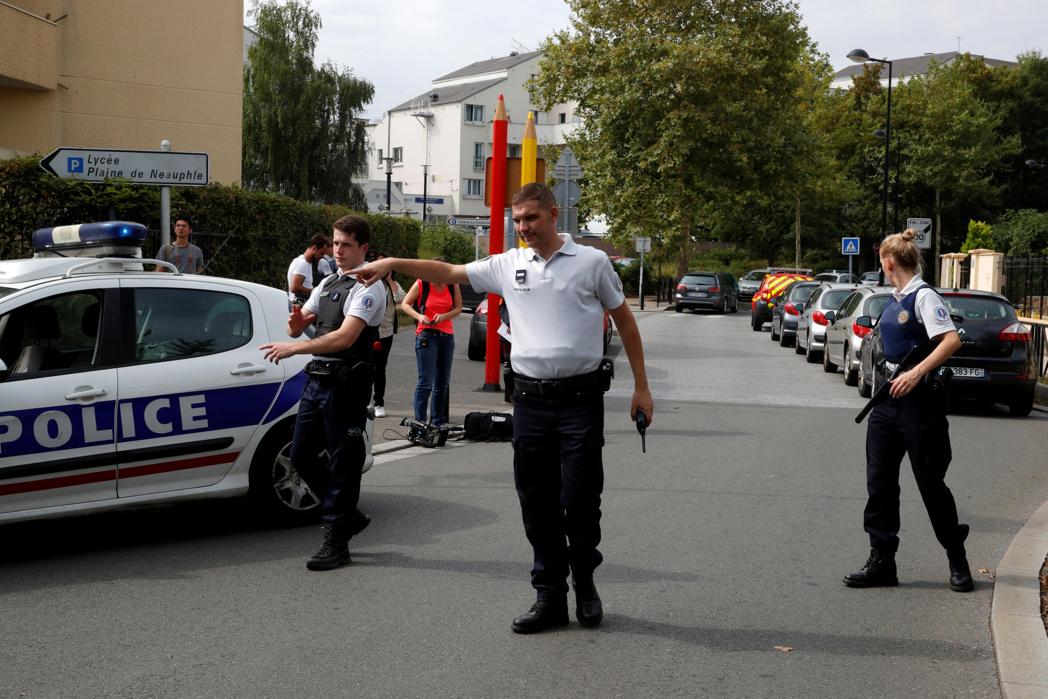 French police secure a street after a man killed two persons and injured an other in a knife attack in Trappes. (Reuters)