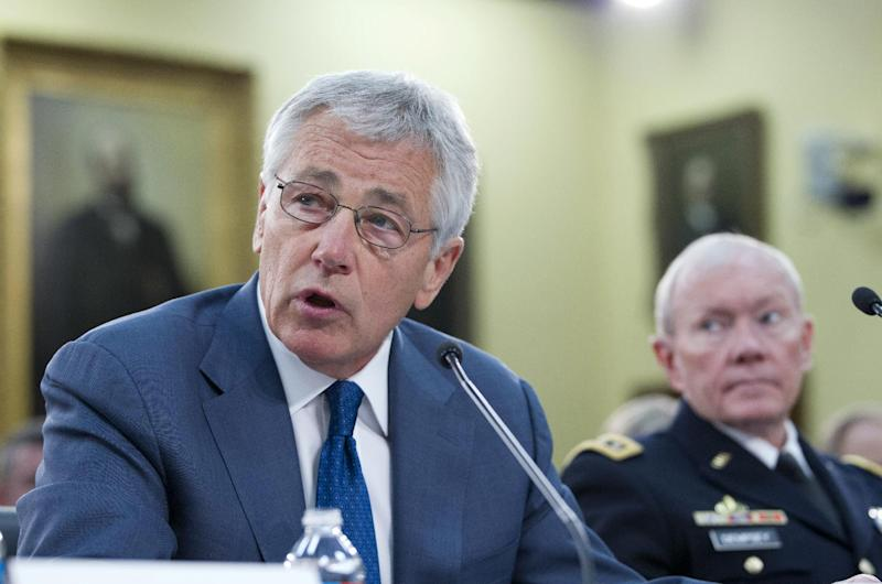 Defense Secretary Chuck Hagel, accompanied by Joint Chiefs Chairman Gen. Martin E. Dempsey, testifies on Capitol Hill, in Washington, Tuesday, April 16, 2013, before the House Defense subcommittee hearing on the Defense Department's fiscal 2014 budget. (AP Photo/Jose Luis Magana)