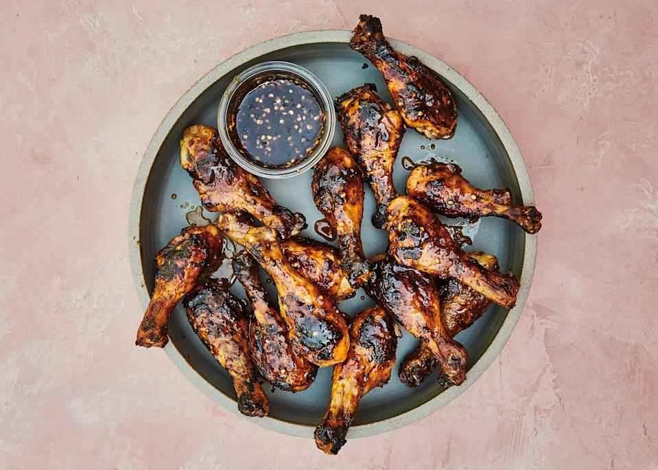 "For this grilled chicken recipe, cooking the legs over indirect heat gives them time to render fully and start to crisp so they won't become gluey when glazed. Try this savory caramel glaze on whole fish or lamb kebabs. <a href=""https://www.bonappetit.com/recipe/chicken-drumsticks-with-savory-caramel?mbid=synd_yahoo_rss"" rel=""nofollow noopener"" target=""_blank"" data-ylk=""slk:See recipe."" class=""link rapid-noclick-resp"">See recipe.</a>"