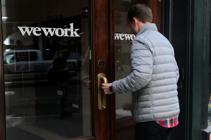 A man walks into a WeWork space in the Manhattan borough of New York City, New York, U.S., October 4, 2019. REUTERS/Carlo Allegri