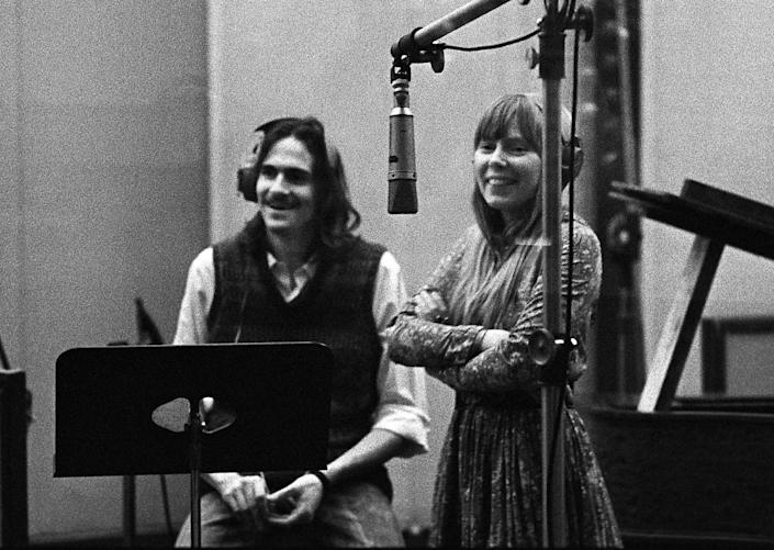 James Taylor and Joni Mitchell in a recording studio in Los Angeles in 1971.
