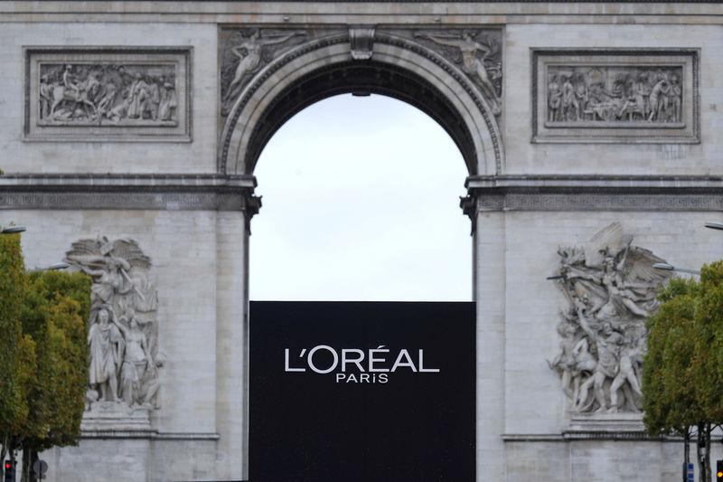 FILE PHOTO: The logo of French cosmetics group L'Oreal is seen in front of the Arc de Triomphe during a public event in Paris