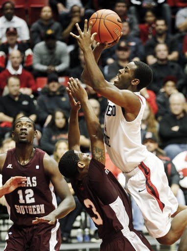 San Diego State guard Xavier Thames, top right, shoots over Texas Southern guard Madarious Gibbs during the first half of their NCAA college basketball game, Monday Dec. 3, 2012, in San Diego. (AP Photo/Lenny Ignelzi)