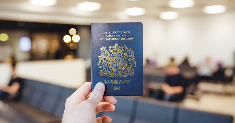 De La Rue drops blue British passport bid, says profit hit