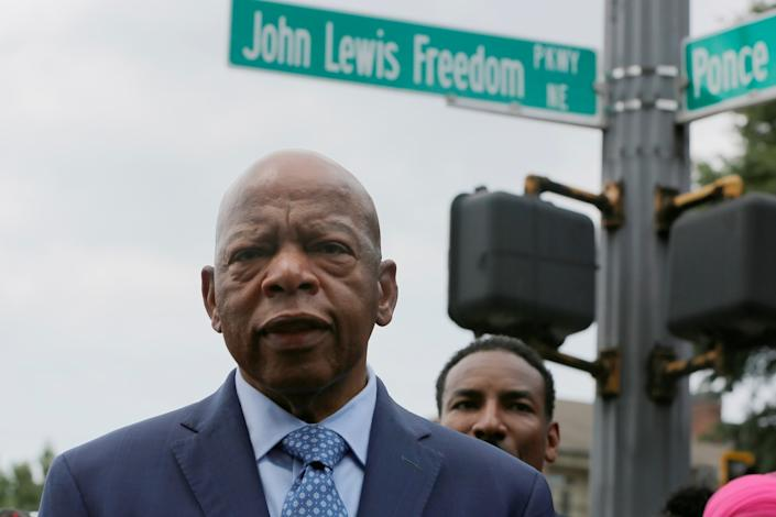 Rep. John Lewis stands in front of John Lewis Freedom Parkway moments after its new name was unveiled in Atlanta on Aug. 22, 2018.