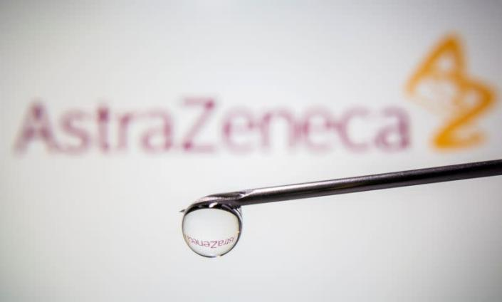 FILE PHOTO: AstraZeneca's logo is reflected in a drop on a syringe needle in this illustration