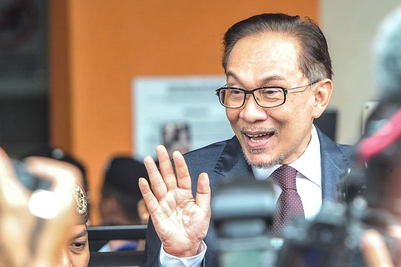 PKR's Datuk Seri Anwar Ibrahim waves to the crowd with his early release from imprisonment after receiving a full pardon, which will enable him to actively participate in politics. — Picture by Shafwan Zaidon
