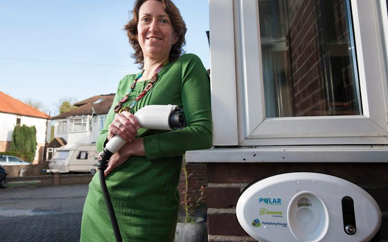 Fiona Morgan shown holding the charging cable for electric vehicles (EVs) recently installed at her home - Andrew Crowley
