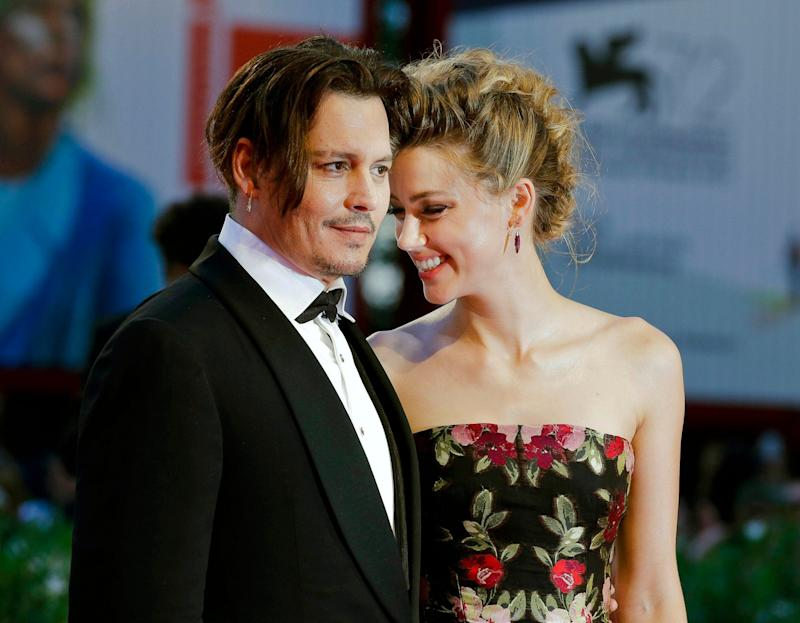 "Johnny Depp, left, and Amber Heard arrive at the premiere of the film ""The Danish Girl"" at the Venice Film Festival in September 2015 - Credit: Andrew Medichini/AP"