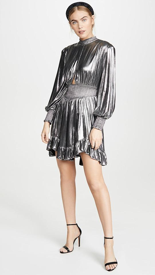 """<p>Stand out from the crowd in this <a href=""""https://www.popsugar.com/buy/Retrofete-Melody-Dress-517809?p_name=Retrofete%20Melody%20Dress&retailer=shopbop.com&pid=517809&price=475&evar1=fab%3Aus&evar9=46917742&evar98=https%3A%2F%2Fwww.popsugar.com%2Ffashion%2Fphoto-gallery%2F46917742%2Fimage%2F46917764%2FRetrofete-Melody-Dress&list1=shopping%2Cdresses%2Cparty%20dresses%2Choliday%2Cwinter%2Ccocktail%20dresses%2Cwinter%20fashion&prop13=mobile&pdata=1"""" rel=""""nofollow"""" data-shoppable-link=""""1"""" target=""""_blank"""" class=""""ga-track"""" data-ga-category=""""Related"""" data-ga-label=""""https://www.shopbop.com/melody-dress-retrofete/vp/v=1/1591474213.htm?folderID=13371&amp;fm=other-shopbysize-viewall&amp;os=false&amp;colorId=12345"""" data-ga-action=""""In-Line Links"""">Retrofete Melody Dress</a> ($475).</p>"""