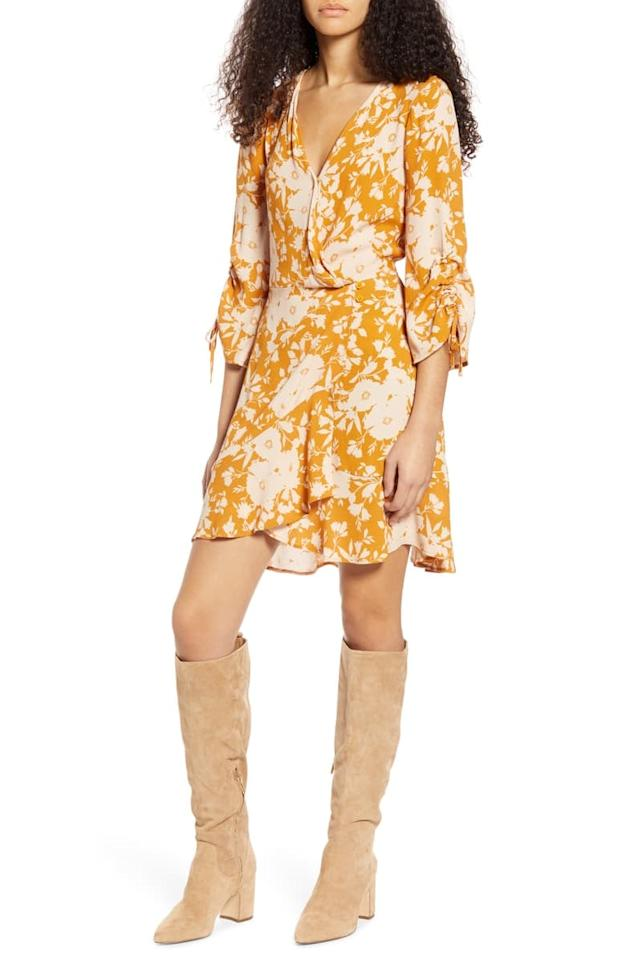 "<p><a href=""https://www.popsugar.com/buy/Band-Gypsies-Waikiki-Faux-Wrap-Minidress-554557?p_name=Band%20of%20Gypsies%20Waikiki%20Faux%20Wrap%20Minidress&retailer=shop.nordstrom.com&pid=554557&price=47&evar1=fab%3Aus&evar9=46071227&evar98=https%3A%2F%2Fwww.popsugar.com%2Ffashion%2Fphoto-gallery%2F46071227%2Fimage%2F47286146%2FBand-Gypsies-Waikiki-Faux-Wrap-Minidress&list1=trends%2Cspring%20fashion%2Csummer%20fashion%2Caffordable%20shopping&prop13=mobile&pdata=1"" rel=""nofollow"" data-shoppable-link=""1"" target=""_blank"" class=""ga-track"" data-ga-category=""Related"" data-ga-label=""https://shop.nordstrom.com/s/band-of-gypsies-waikiki-faux-wrap-minidress/5483620/full?origin=category-personalizedsort&amp;breadcrumb=Home%2FWomen%2FClothing%2FDresses&amp;color=gold"" data-ga-action=""In-Line Links"">Band of Gypsies Waikiki Faux Wrap Minidress</a> ($47, originally $78)</p>"