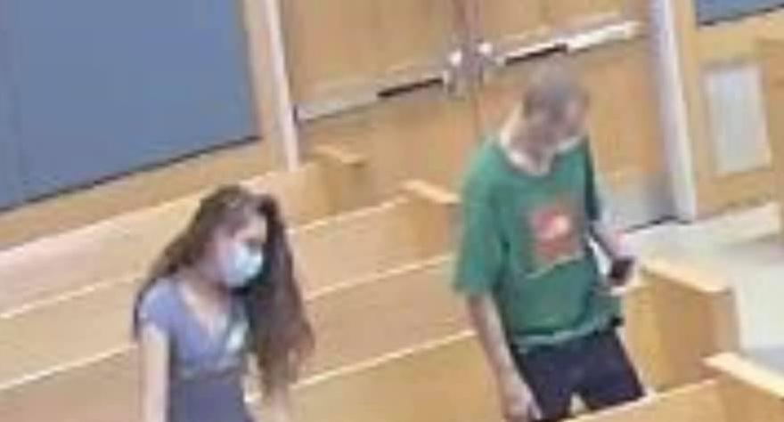 Two people pictured in court in South Carolina, including a man wearing a T-shirt singled out in an alleged theft..