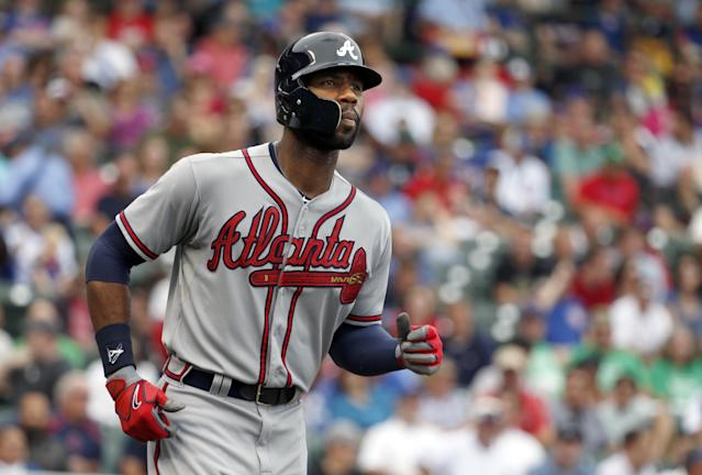 Atlanta Braves' Jason Heyward heads to first after drawing a walk from Chicago Cubs starting pitcher Scott Baker during the third inning of a baseball game Friday, Sept. 20, 2013, in Chicago. (AP Photo/Charles Rex Arbogast)
