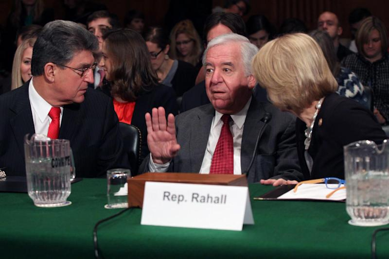 From left, Sen. Joe Manchin, D-W.Va., Rep. Nick Rahall. D-W.Va. and Rep. Shelly Moore Capito, R-W.Va. confer on Capitol Hill in Washington, Tuesday, Feb. 4, 2014, prior to testifying before the Senate subcommittee on Water and Wildlife hearing to examine the safety and security of drinking water supplies following the Central West Virginia drinking water crisis. (AP Photo/Lauren Victoria Burke)