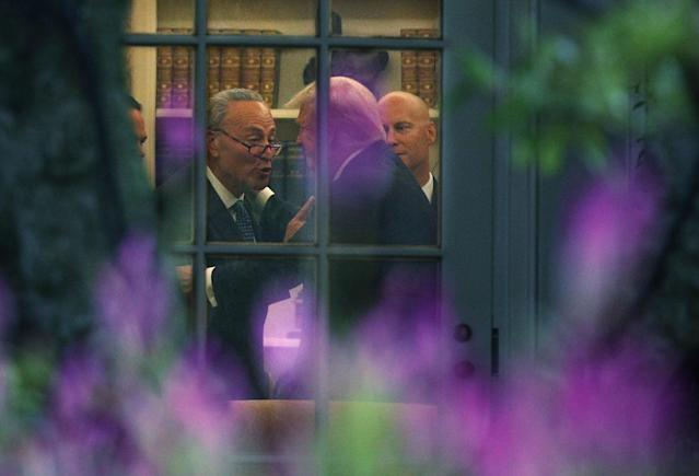 Senate Minority Leader Chuck Schumer, left, makes a point to President Trump in the Oval Office Sept. 6. (Photo: Alex Wong/Getty Images)