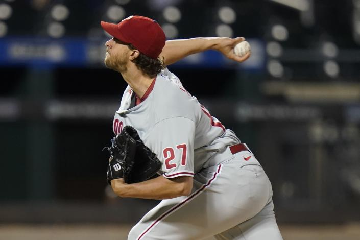 Philadelphia Phillies' Aaron Nola throws during the first inning against the New York Mets in the second baseball game of a doubleheader Tuesday, April 13, 2021, in New York. (AP Photo/Frank Franklin II)