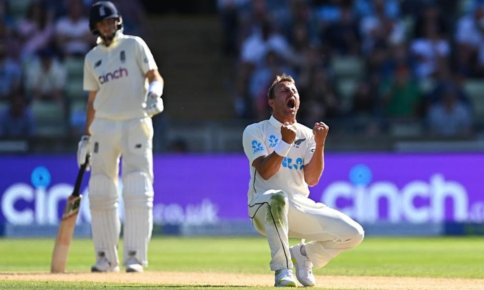 Neil Wagner picks up the wicket of Ollie Pope as England captain Joe Root looks on ruefully.