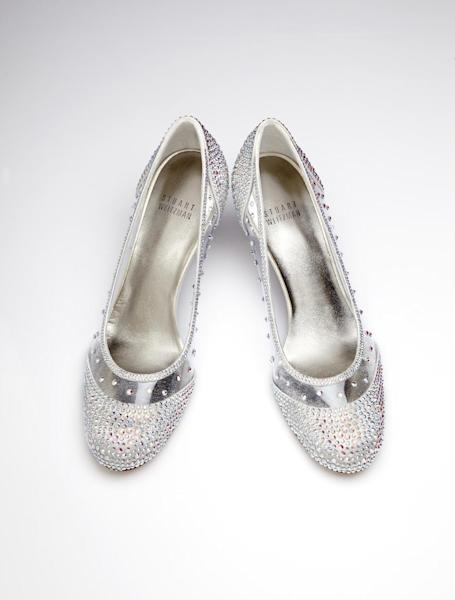 "This image released by Stuart Weitzman shows a pair of glass slippers designed by Stuart Weitzman that will be worn by actress Laura Osnes in the title role of the Broadway musical, ""Rodgers + Hammerstein's Cinderella on Broadway."" Weitzman knows how to make shoes that make a splash. For years, he made the ""million-dollar Oscar shoes,"" diamond-covered footwear that a celebrity would wear to the Academy Awards. He employed a welded-construction technique that uses no screws so that Cinderella could have a seamless look. (AP Photo/Stuart Weitzman )"